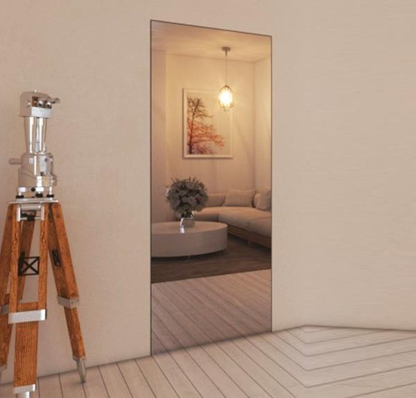 Flush-to-wall door with external mirror and invisible handle